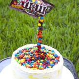 Illusion cake with M&Ms and swiss meringue buttercream Frosting