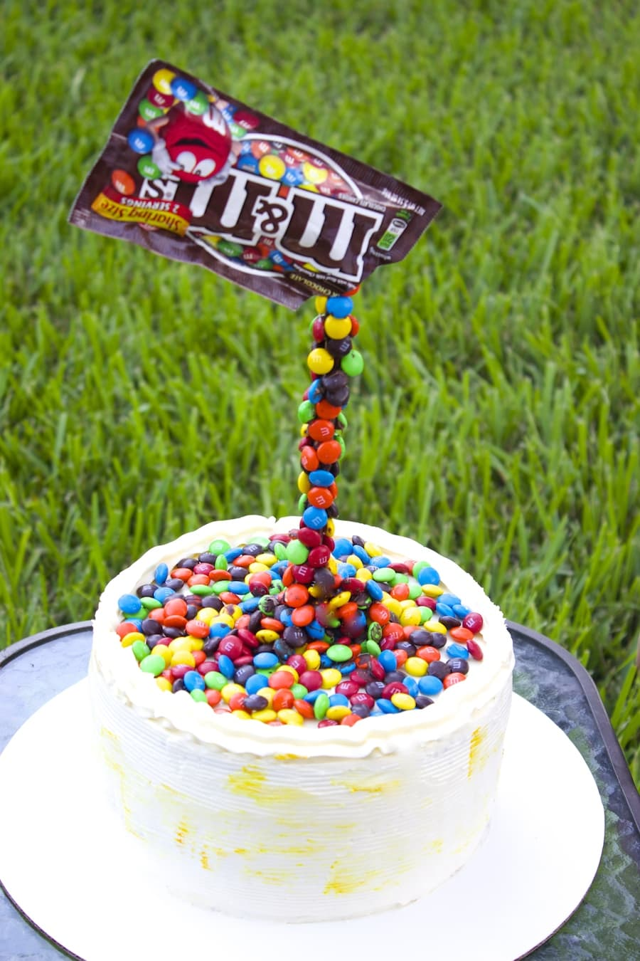 M&M Illusion cake Swiss meringue buttercream Frosting,gravity defining cake, part cake, m&m cake, kids birthday cake ideas, kids birthday cake, illusion cakes